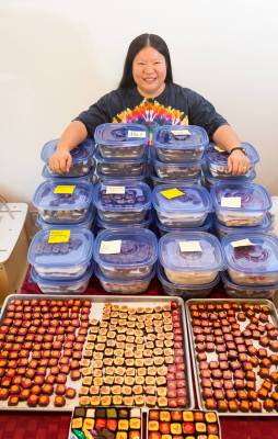 Tien with 136 pounds of chocolates