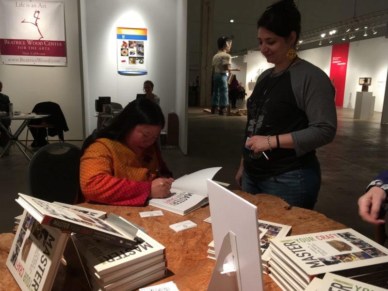 Signing books at SOFA Chicago