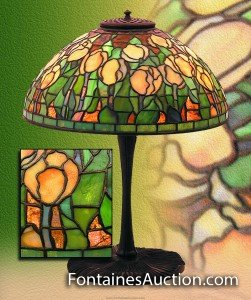 Tiffany Studios Yellow TulipTable Lamp. 14''domical shade of yellow tulip blossom and green leaves with brown background of fractured glass. Shade signed Tiffany Studios New York 1905. Est. $30,000-35,000. Tiffany Antique Lamps and Lighting