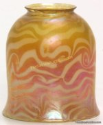 """Tiffany Favrile King Tut Shade. Rare gold iridescent translucent artglass shade is decorated with a white opaque King Tut pattern; signed """"L.C.T."""","""