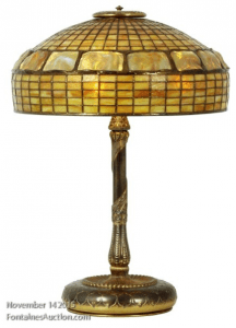 Another great example of one of the original Tiffany lamps sold at Fontaine's auction - Gold Turtleback Table Lamp. Price Realized: $24,200.00