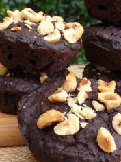 Black bean brownie muffins with roasted hazelnuts on top