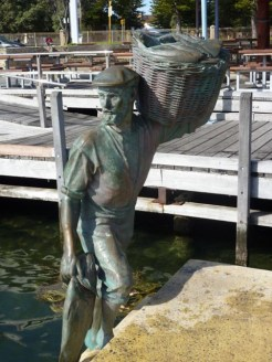 Bronze statue of sailor carrying basket of fish - Fremantle, WA