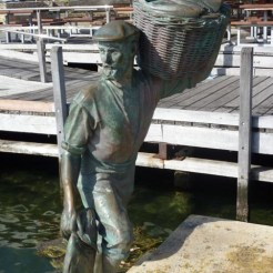 Bronze statue of sailor carrying basket of fish - Fremantle, WA