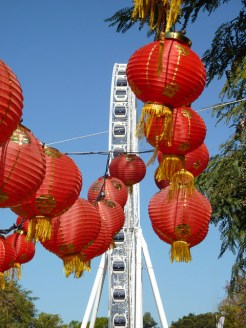Red Chinese lanterns contrast against a blue sky at a Queensland Food Festivals