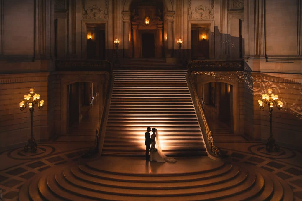 Create Client Experiences: Silhouetted Couple In Embrace By The Staircase