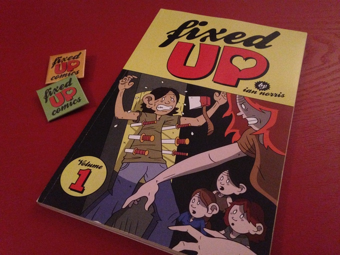 Fixed Up Vol. 1 book and badge