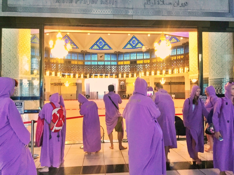 people in purple robes