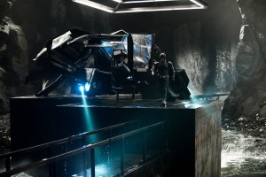 batman and the batwing from the bat movie in the batcave