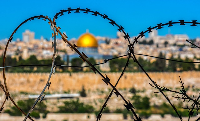 Barbed wire with Al-Asqa mosque in distance
