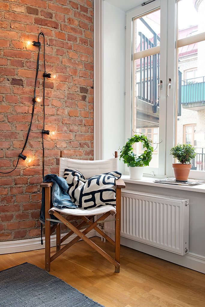 exposed brick with chair