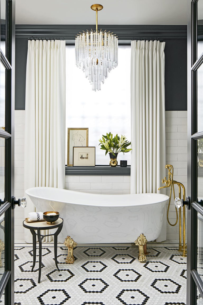 Vintage glam bathroom in black white and gold