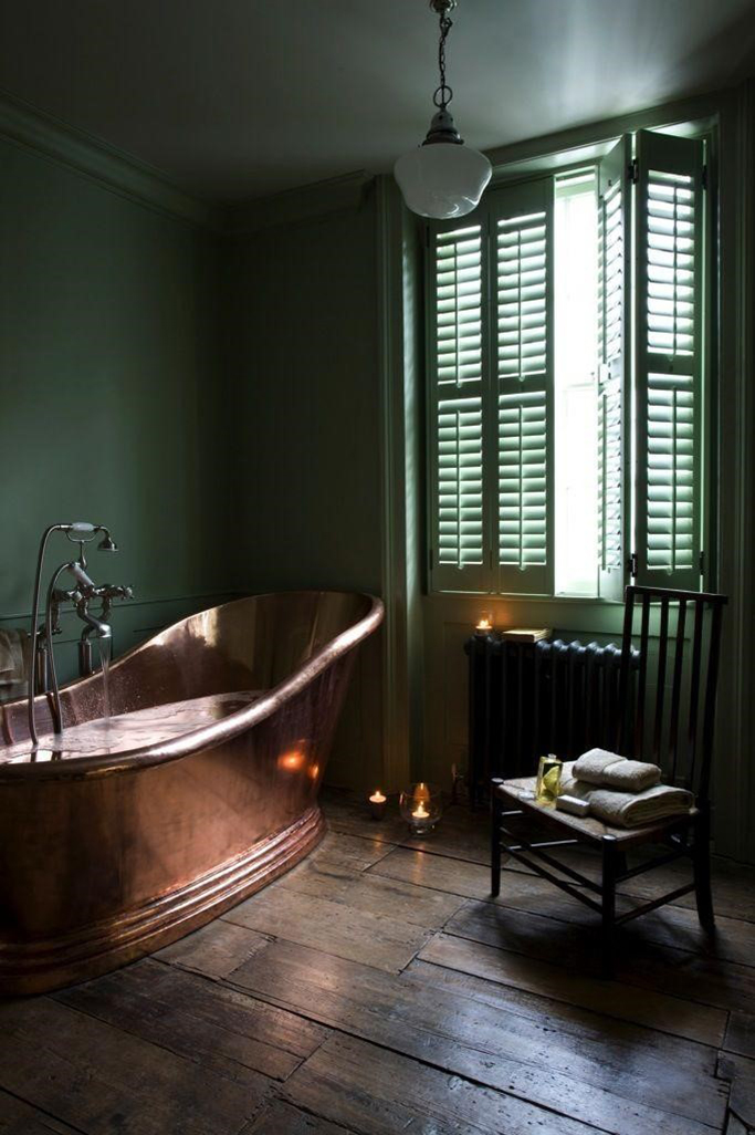 intage style bathroom with copper roll top tub