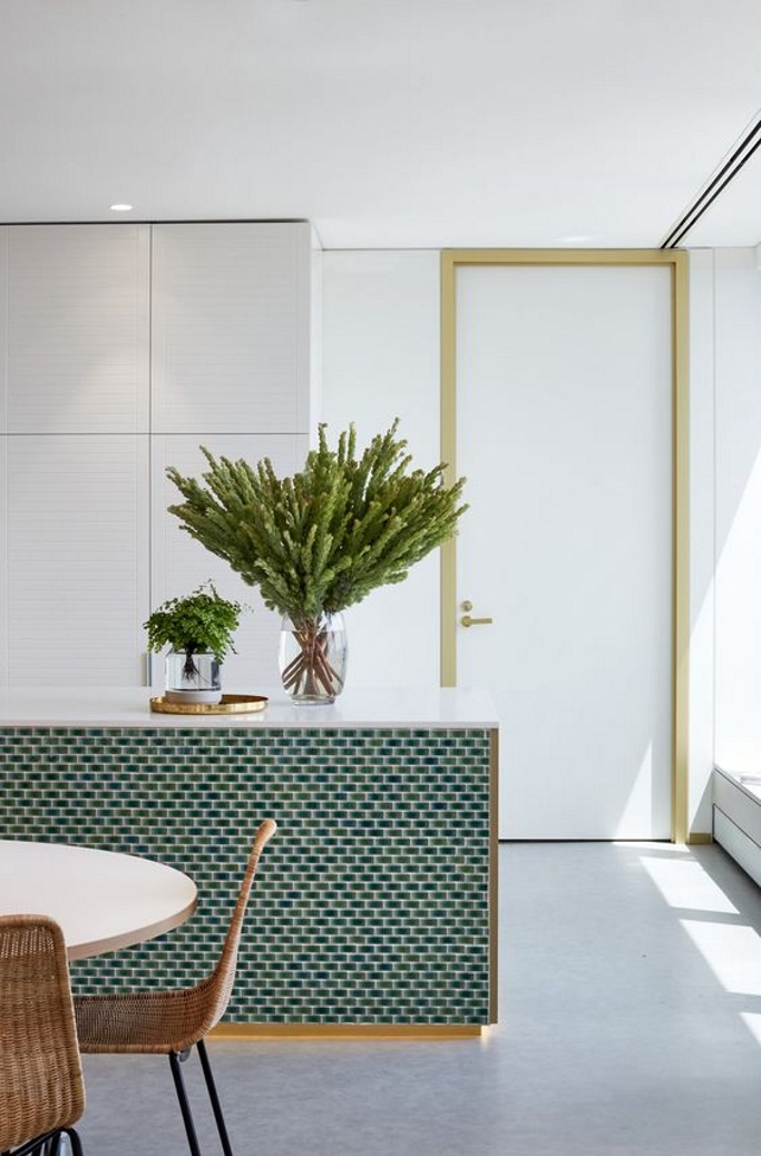 5454173600ba As a lover of all things brass, gold and shiny, this jaw-dropping kitchen  island had me at hello. I love the use of mini metro tiles to draw  attention to ...