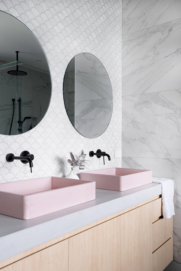 Pink concrete sink in grey and natural wood bathroom