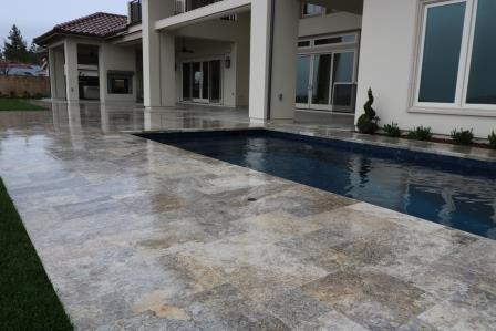 Leo Reynaga headed the exterior portion of this project, the Hoffman residence in Fresno, Calif., consisting of Versailles Pattern 3CM travertine pavers running through the edges of the pool deck. His expert ability to prep the substrate made it an easy call to put him on the job. The homeowner wanted as tight of joints as possible, despite the size and variation of the stone.