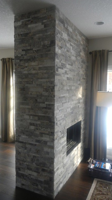 Silver Cubic Ledgestone installed on a fireplace