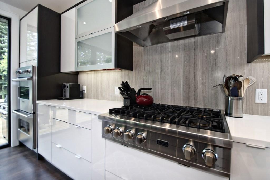Wooden White Bolder Stone Panel installed as a kitchen backsplash