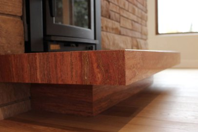 Red Travertine Bolder Stone Panel installed on a fireplace