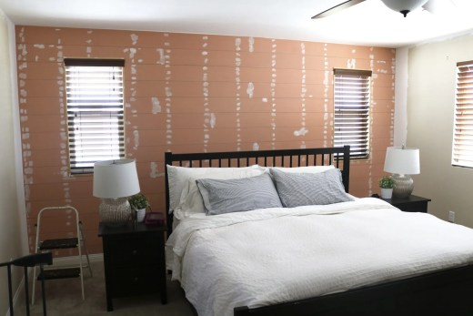 Master bedroom makeover with a shiplap wall and craftsman door casing!