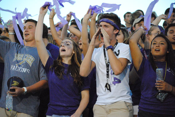 Falcon Fans cheer on their team during a Sept. 4, 2014 football game. Photo by The Creek yearbook photographer Kaitlyn Cass.