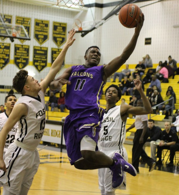Timber Creek takes on Fossil Ridge during a Jan. 24, 2015 game. (Photo by The Creek Yearbook photographer Robert Samudio)