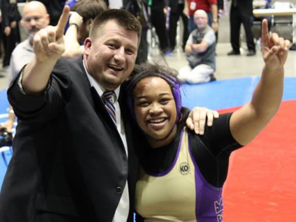 TCHS wrestling coach Brent Wasche (left) stands with state champion wrestler Rachel Bridges (right) following her victory in the 215-pound division of the UIL Class 6A State Wrestling Championships on February 21 in Garland.