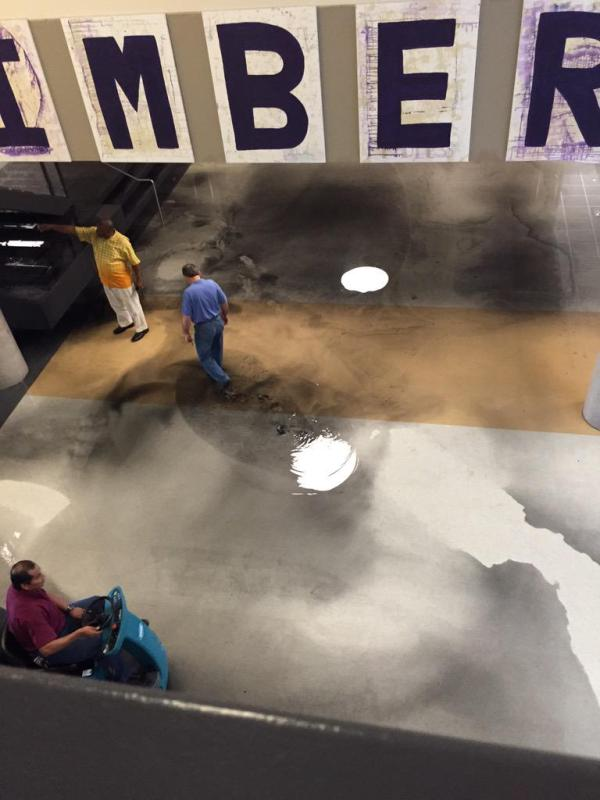 A photo from Talon reporter Gracy Whitaker shows custodial staff cleaning up the broken pipe on June 1, 2015.