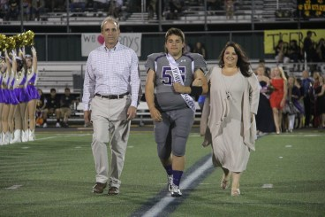 Homecoming court nominees and their parents walk onto the field during the Sept. 11, 2015 Homecoming Game. (Photo by The Creek Yearbook photographer Sabrina Trejo.)