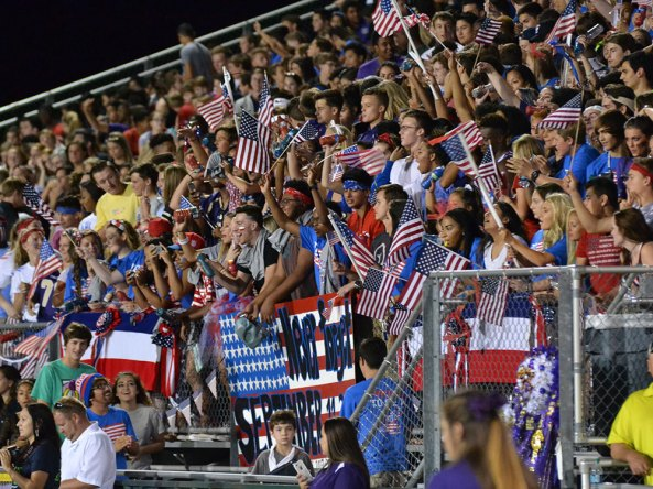 """The TCHS student section """"The Nest"""" cheers during the Sept. 11, 2015 Homecoming game against Irving. (Photo from The Creek Yearbook photographer Phil Oliveria.)"""