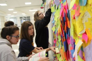 Students post annotations on A's outside Reeves room (Photo by The Creek Yearbook Photographer Milly Orellana)