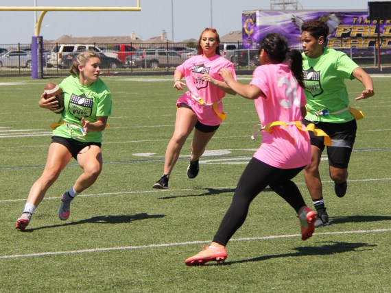 Juniors and Seniors battle during the Powder Puff Football game on May 6, 2016. (Photos by The Creek Yearbook photographer Kelsey Crawford)