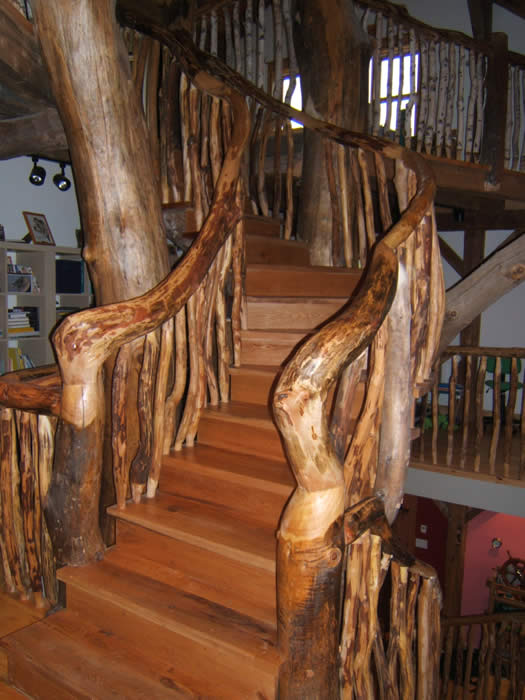 Timber Frame Home With A Tree Staircase