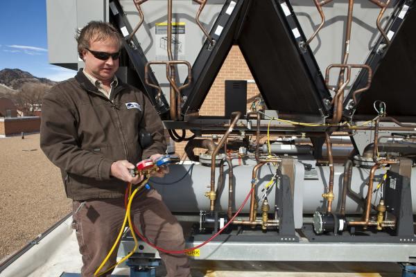 service technichian checking ventilation