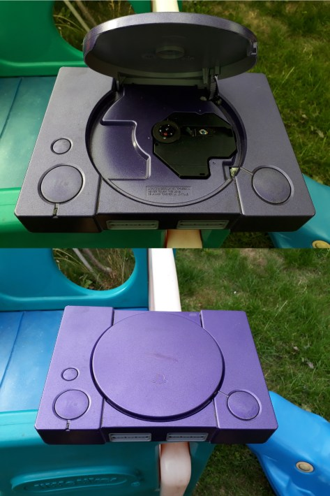 An original Playstation that has been spray painted metallic purple