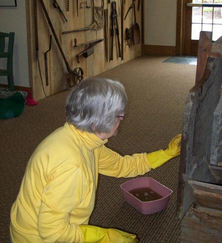 Farm Exhibit - Carol cleaning Fanning Mill