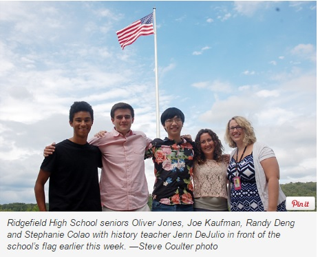 Time Capsule History Lesson - Students in front of Flag