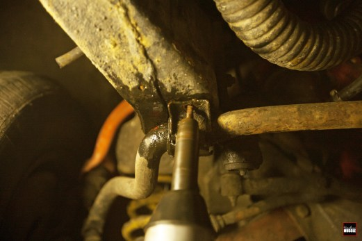 Up next, we removed the U-plates that not only house the OEM rubber bushings...