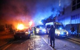 Police officers hurt, vehicles set on fire in violent protest in ...
