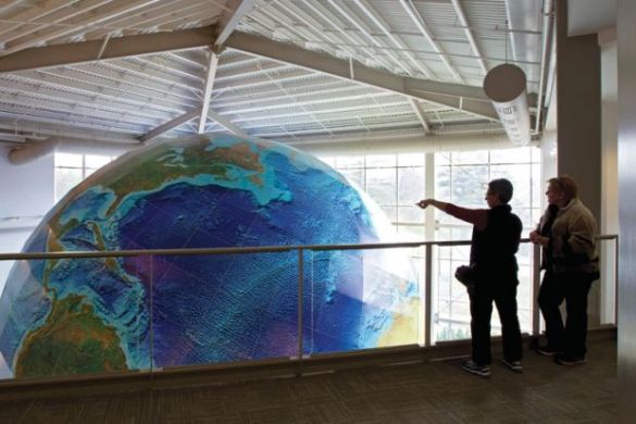 New tool aims to boost universities  flagging green efforts   THE News People viewing rotating globe  DeLorme Map Store  Yarmouth  Maine