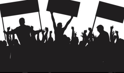 A silhouette of a political rally
