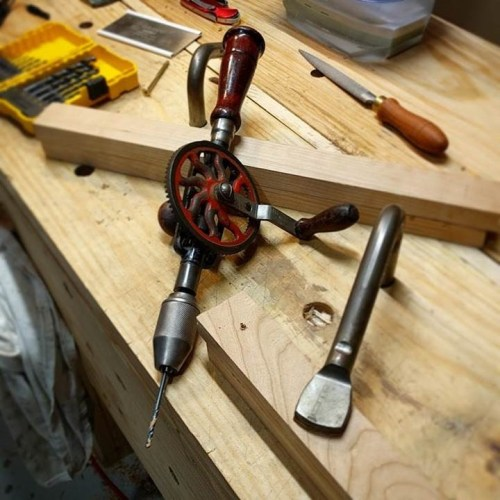 A Millers Falls hand drill bores pilot holes in this oak.
