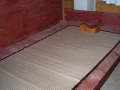 Karina's Bett mit Holzkissen