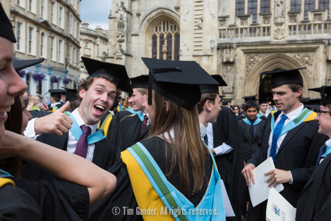 A University of Bath graduate smiles and gives the camera a thumbs up