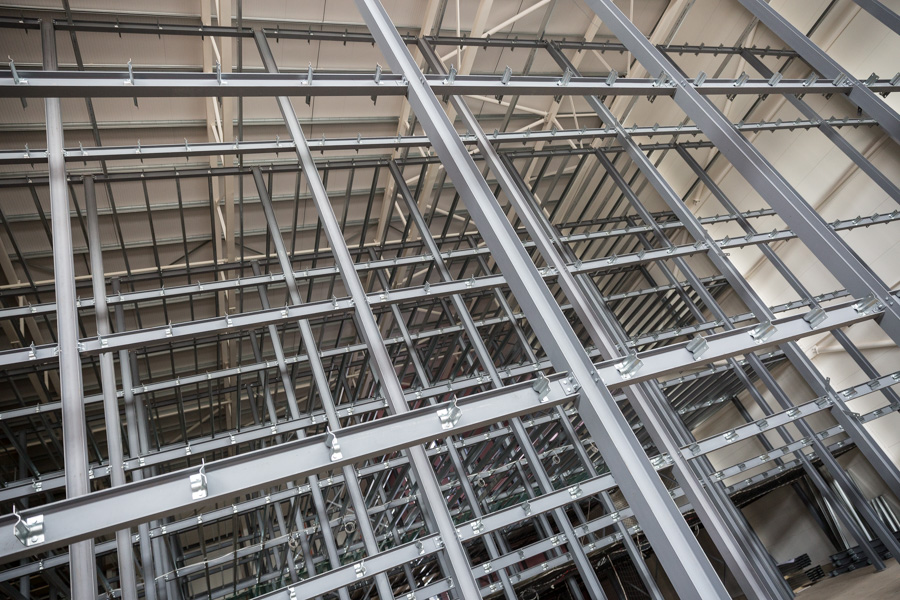 The steel lattice structure inside the new storage facility taken at an upward angle.