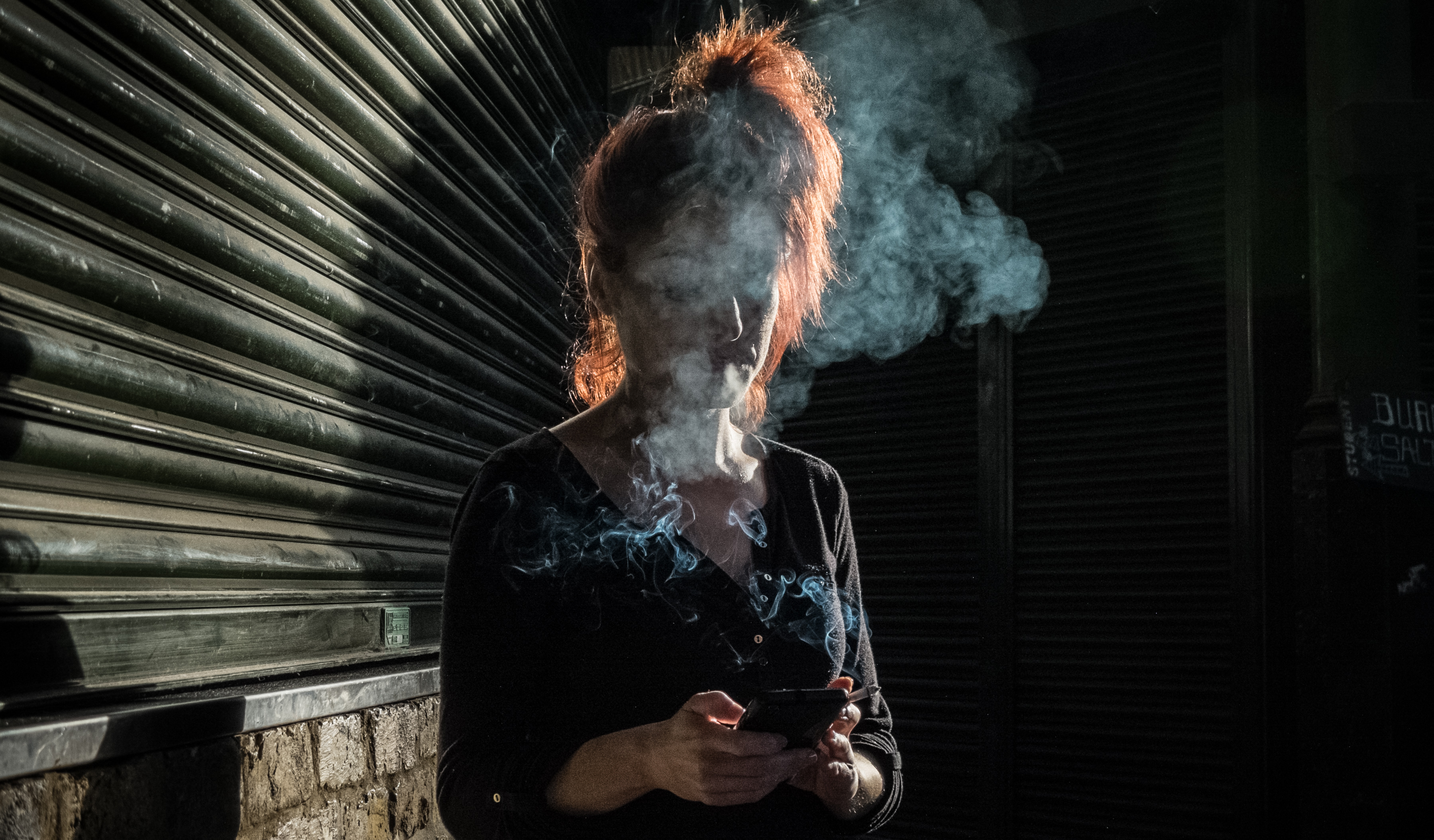 30/04/2016 32-year-old Victoria Venteo takes a cigarette break towards the end of her shift as a waitress at Bedales wine bar in Borough Market, Southwark, London, UK. Photo © Tim Gander 2016. All rights reserved.
