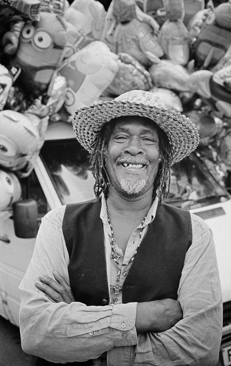 Bad Rasta travels the country selling merchandise at carnivals. Pictured here at Frome Carnival, Somerset, UK.