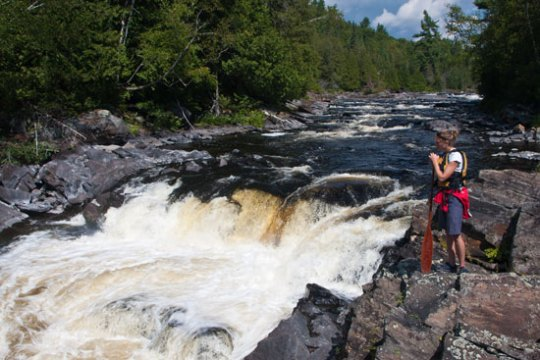 Heidi Braun scouting rapids, Coulonge River, Quebec