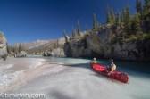 two canoers padding Snake River near milk Creek tributary, Yukon