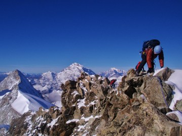 Summit ridge of Cheilion with Grand Combin and Mt Blanc behind